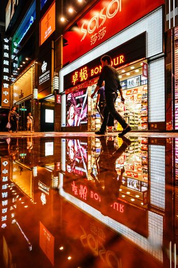 Streetphotography Artisanandartist Nightshooters Reflection Discoverhongkong Illuminated Communication Text Built Structure People Architecture Travel Real People Adult Women Leisure Activity Night Reflection Men Glass - Material Technology Indoors  City Transportation