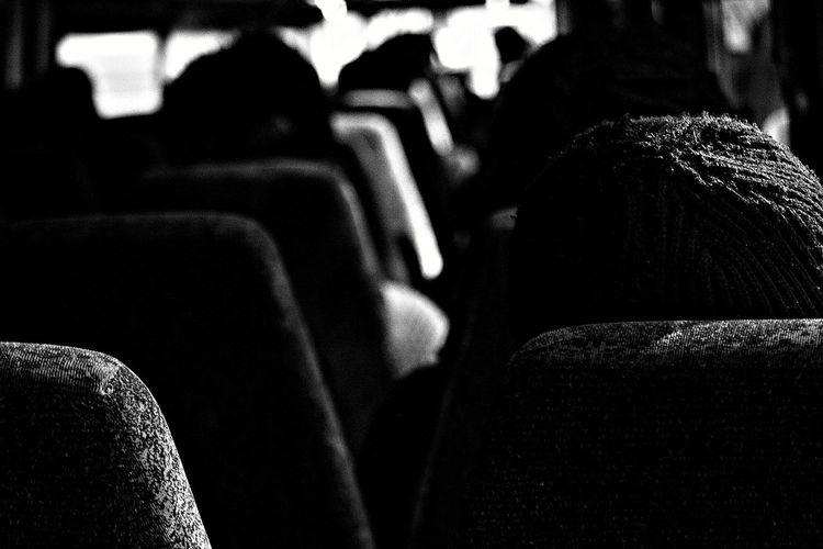 Strangers.....The Street Photographer - 2016 EyeEm Awards Blackandwhite Photography Buslife Seats Rows Beanie