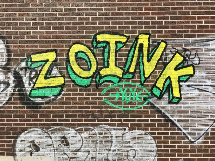 Text Western Script Brick Wall Communication Brick Wall No People Wall - Building Feature Built Structure Graffiti Day Multi Colored Creativity Green Color Art And Craft Outdoors Architecture Building Exterior Pattern Capital Letter