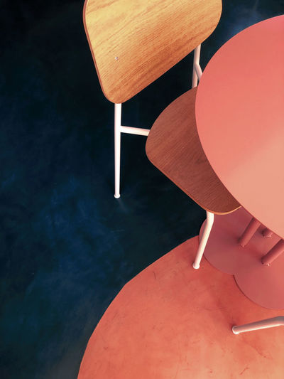 High angle view of empty chair by table