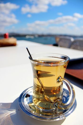 Sunny Summer Apple Tea Tea EyeEm Selects Drink Alcohol Drinking Glass Sea Cold Temperature Frothy Drink Close-up Sky Food And Drink Hot Drink Shore Non-alcoholic Beverage Herbal Tea Tea Cup
