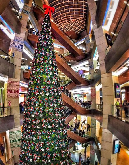 The Culture Of The Holidays The largest xmas tree in Chile Xmas In Summer Summertime Xmas Tree Costanera Center Indoors  Decoration Abundance Large Group Of Objects Retail  Person Multi Colored Arrangement