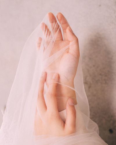 Close-Up Of Woman Holding Veil