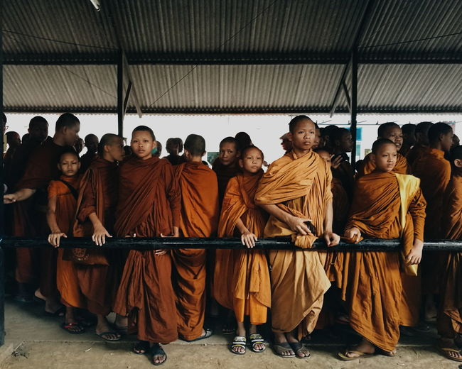 Monks standing in temple