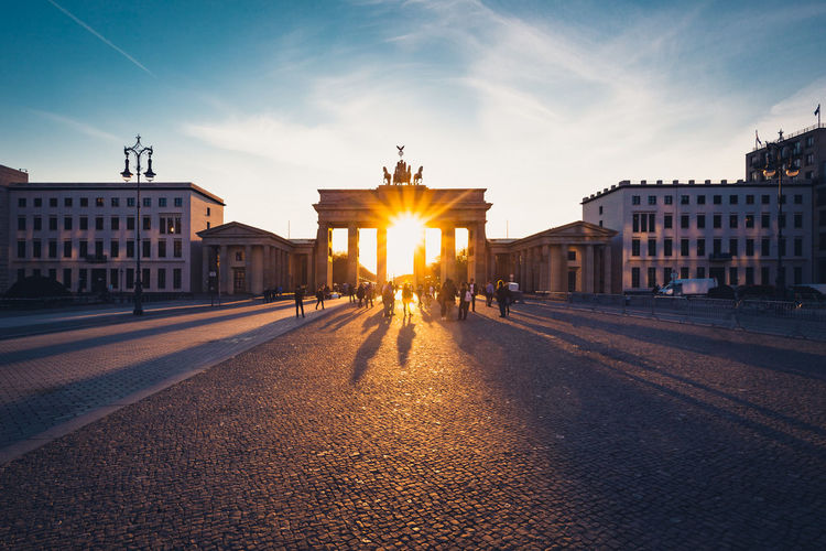Brandenburger Tor at sunset in central Berlin Architectural Column Architecture Berlin Brandenburg Gate Brandenburger Tor Building Exterior Built Structure City City Gate Famous Place Landmark Neighborhood Map Outdoors Real People Sight Sky Statue Sun Sunbeam Sunlight Sunset Sunsets Tourism Travel Destinations
