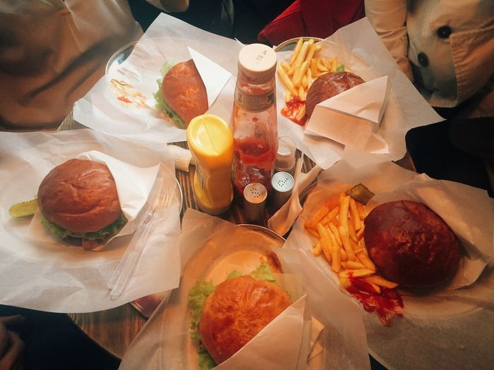 High Angle View Of Burgers And Fries On Table