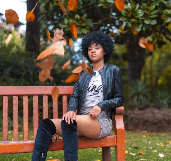 Portrait of boy sitting on bench