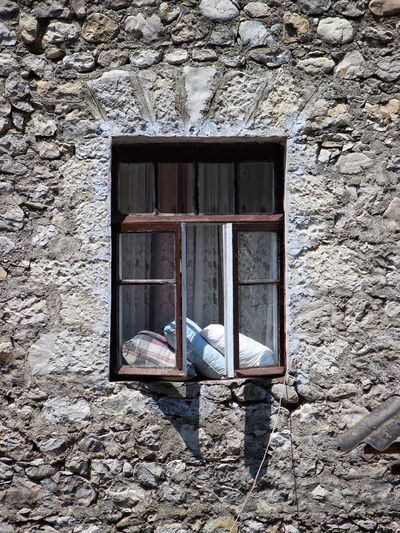 Window of guest house Wood And Bricks Single Window Sunny Afternoon Guest House Old Structures Drying Clothes Waiting For Guests Pillows Old Window House Exterior Open Window Open Window Brick Building Brick Wall Window Frame Window Architecture Built Structure Window Day Building No People Building Exterior Old Wall House Wall - Building Feature Abandoned Broken
