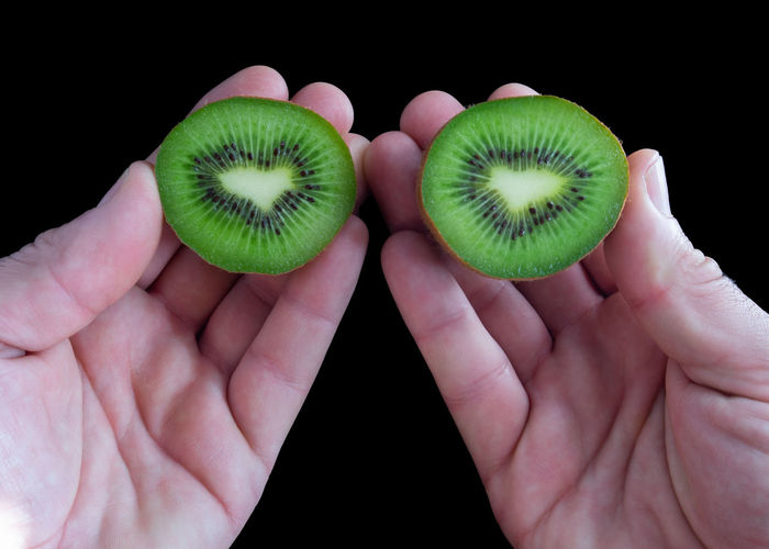 Human Hand Human Body Part Hand Holding Black Background Studio Shot Body Part Healthy Eating Wellbeing Close-up Indoors  Green Color Human Finger Fruit Finger One Person Food And Drink Real People Unrecognizable Person Kiwi Kiwi - Fruit Autumn Mood