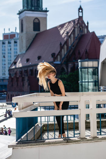 Architecture Beautiful Woman Beauty Blond Hair Building Building Exterior Built Structure Casual Clothing City Day Fashion Hair Hairstyle Leisure Activity Lifestyles One Person Outdoors Real People Women Young Adult Young Women