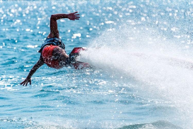 Man Flyboarding In Sea