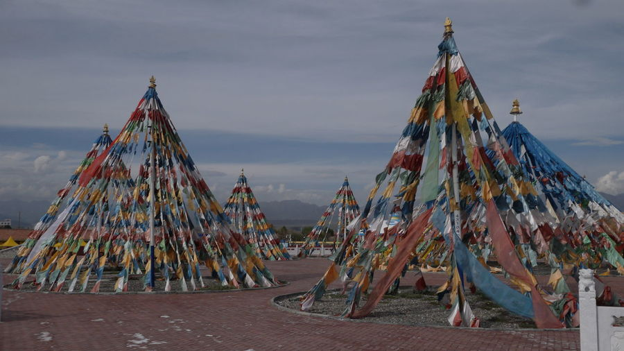 Panoramic view of flags hanging against sky