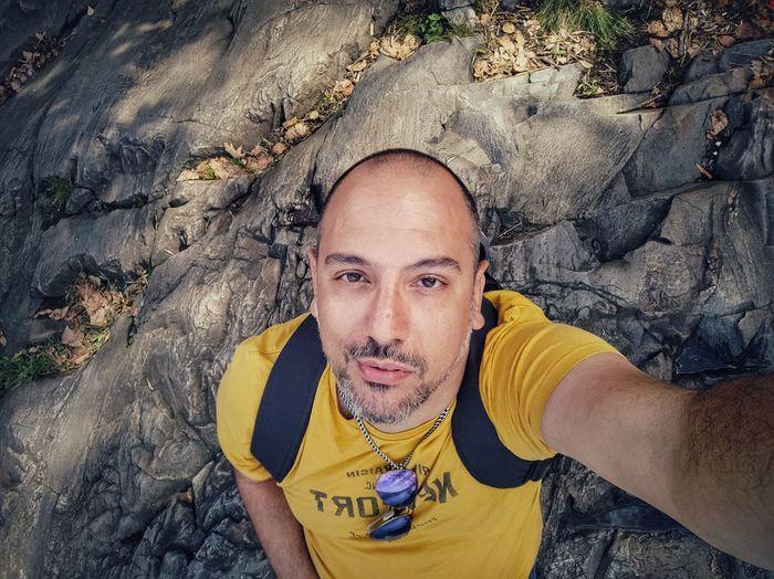 High angle portrait of man on rock