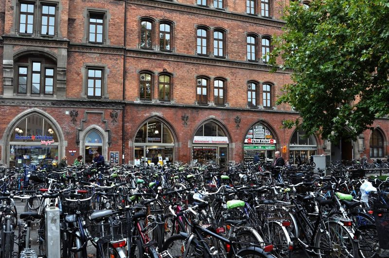 Bicycle Bike Bike Parking Bike Rack Bike Ride Building Building Exterior Celebrate Your Ride City Life Day Façade In A Row Many Bikes Mode Of Transportation Munich No People Outdoors Parking Lot Residential District Side By Side Urban