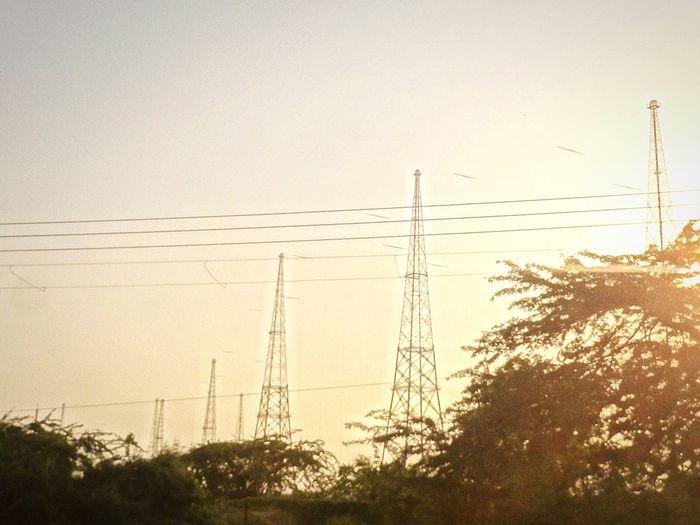 Electricity pylon against sky