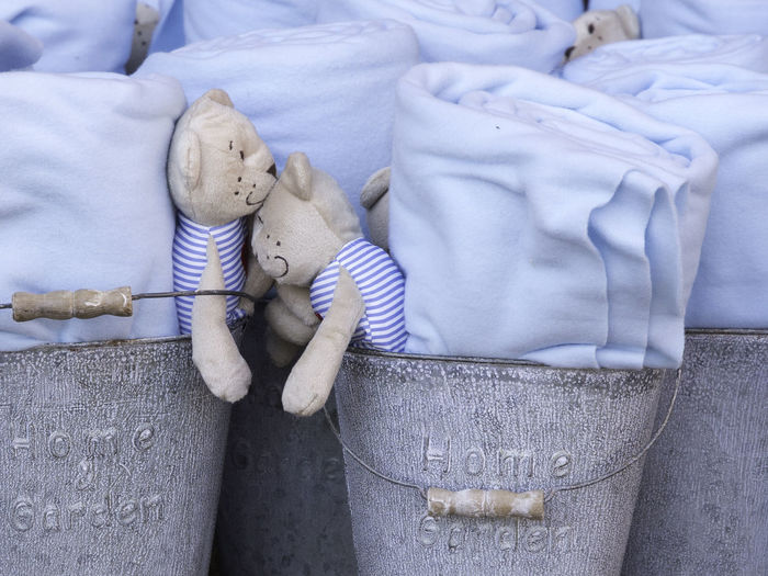 Close-up of toys and blankets in buckets