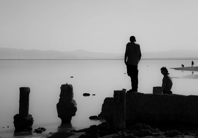 Bombay Beach Silhouettes Beauty In Nature Bombay Beach California Calm Day Horizon Over Water Idyllic Leisure Activity Lifestyles Mammal Monochrome Nature Other Desert Cities Outdoors Salton Sea Scenics Sky Tranquil Scene Tranquility Water