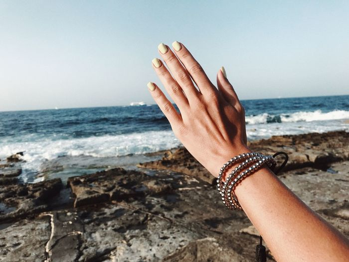 Hello EyeEm Selects Sea Water Beach Human Body Part Sky Land One Person Horizon Over Water Human Hand Horizon Hand Lifestyles Real People Clear Sky Leisure Activity Body Part Outdoors Nature Motion Finger