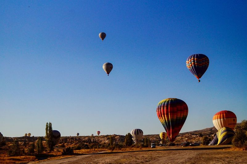 Air Vehicle Hot Air Balloon Balloon Transportation Sky Flying Mid-air Adventure Low Angle View Ballooning Festival Travel Destinations Clear Sky Landscape Multi Colored Tourism EyeEmNewHere It's About The Journey It's About The Journey Moments Of Happiness