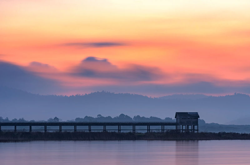 Beautiful morning landscape Pier Bang Phra Reservoir Chonburi, Thailand. Reservoir Bang Phra Nature Water Landscape Thailand Sky Sunset Sunrise Beautiful Background Lake Fishing Coast Horizon Morning Blue Beauty Old Holiday Nobody Wave Cloud Autumn Pond Chonburi Red Pier View Sun Park Tourism Scenic Mountain