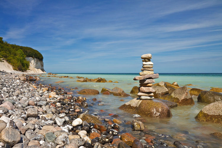 Stack Of Stones On Rock Against Blue Sky