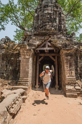 Tomb Raider Style Architecture Famous Place Historic History Leaping Person Running Temples Travel Travel Destinations Woman Worship