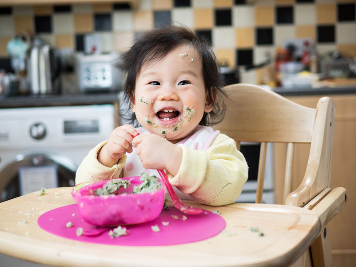 baby girl eating messy Cheerful Childhood Close-up Cute Day Eating Food Food And Drink Happiness Indoors  Lifestyles Looking At Camera Mashed Potatoes One Person People Portrait Real People Sitting Smiling