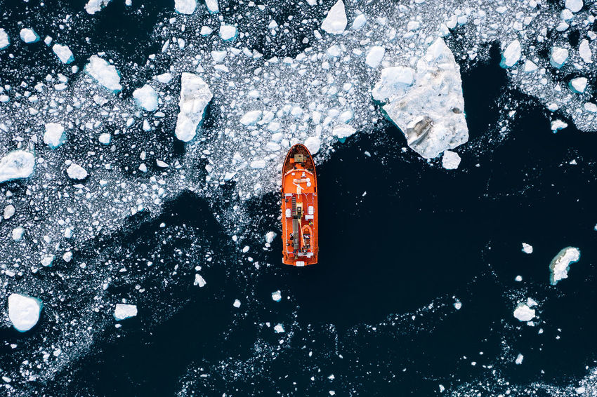 Snow Winter Cold Temperature Nature No People Day Outdoors Red High Angle View Extreme Weather Frozen Snowing Christmas Snowflake Standing Orange Color White Color Water Blizzard Boat Vessel Ice Icebreaker