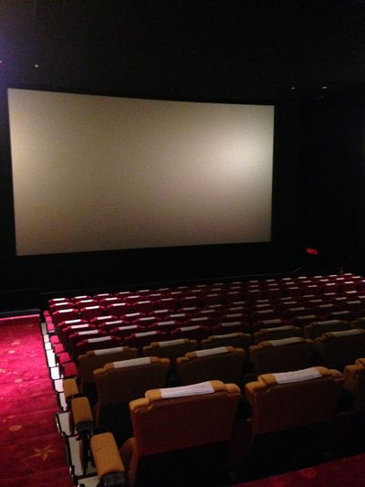 Arts Culture And Entertainment Auditorium Chair Cinema Day Film Industry In A Row Indoors  MOVIE Movie Theater No People Projection Screen Red Seat Stage Theater Theater