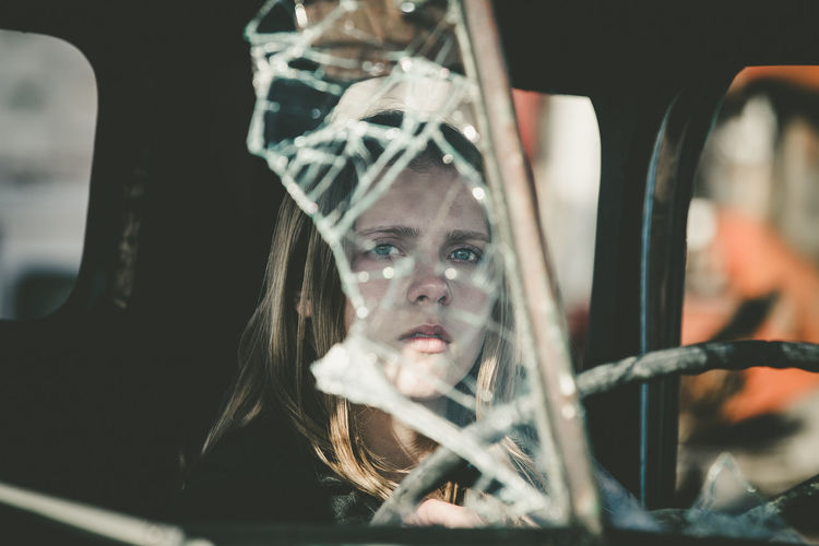 Close-Up Of Woman In Abandoned Car