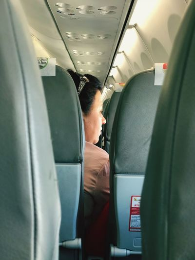 Close-Up Of Woman Sitting In Airplane