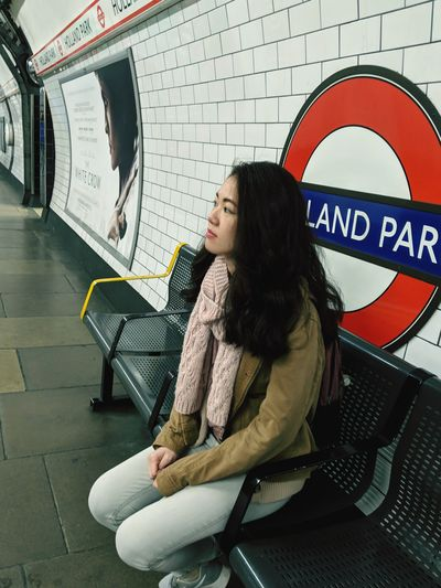 Woman looking away while sitting on seat