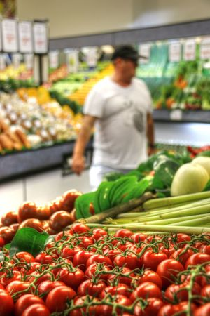Choice Customer  Focus On Foreground Food Food And Drink Fresh Food Fresh Fruits Fresh Vegetables Freshness Fruit Groceries Healthy Eating Healthy Lifestyle Indoors  Market One Person Produce Aisle Retail  Standing Store Supermarket Tomatoes Vegetable Vegetables Red Tomatoes