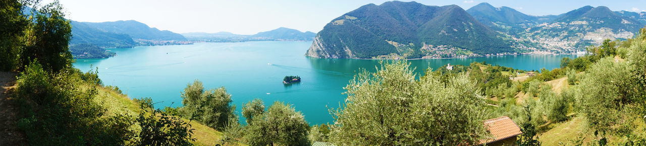Panoramic view of Lake Iseo from Monte Isola, Italy Lake Iseo (italy) Monte Isola Panorama Beauty In Nature Blue Day Lake Lake Iseo Land Monte Isola Monteisola Monteisolalove Mountain Mountain Range Nature Outdoors Panoramic Photography Plant Reflection Scenics - Nature Sea Travel Destinations Tree View From Above Water