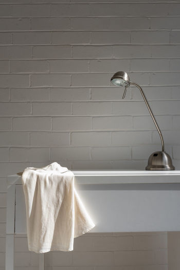 View of electric lamp against wall at home