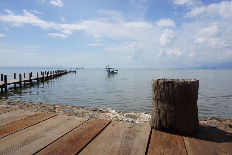 Beauty In Nature Boat At End Of Pier Cloud - Sky Day Horizon Over Water Jetty Nature Nautical Vessel No People Outdoors Pier Pier Scenics Sea Sea And Sky Sky The Sea Tranquil Scene Tranquility Water Wood - Material Wooden Jetty Wooden Path Wooden Post Wooden Walkway EyeEmNewHere Live For The Story