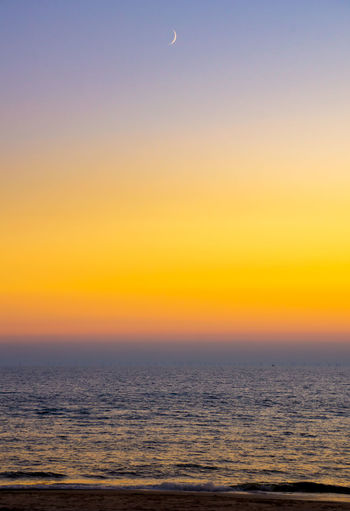Sylt, Germany After Sunset Dusk Horizon Horizon Over Water Idyllic Moon Nature No People North Sea Orange Color Outdoors Scenics - Nature Sea Sky Sunset Sylt Tranquil Scene Water