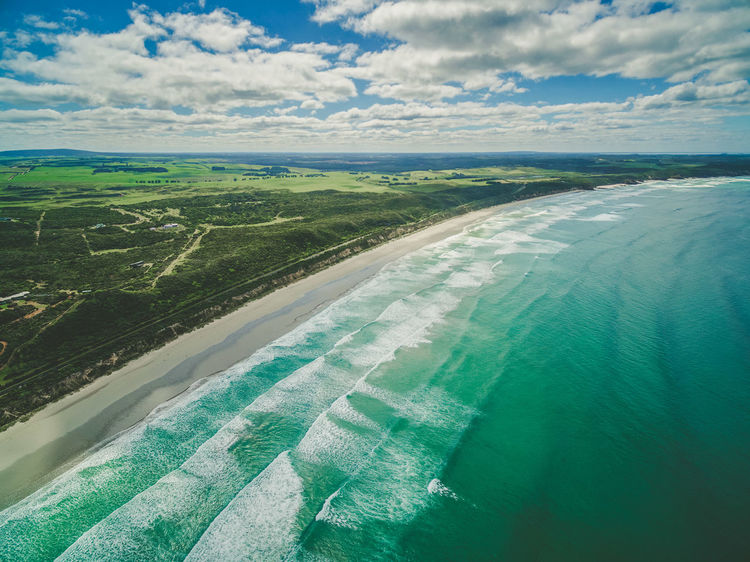Aerial view of beautiful ocean coastline, white sandy beach, and farm lands in Australia Australia Drone  Aerial Landscape Aerial View Agriculture Airplane Beauty In Nature Cloud - Sky Day Drone Photography Field Green Color Landscape Nature No People Outdoors Patchwork Landscape Rural Scene Scenics Sky Tranquil Scene Tranquility Travel Destinations View Into Land Water