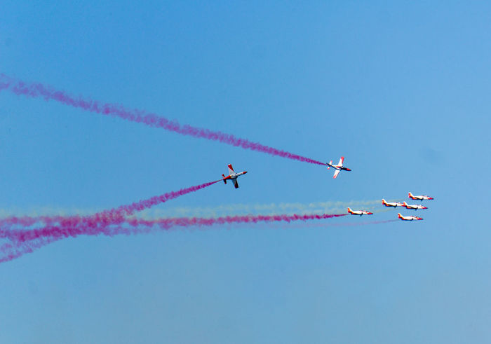 Air Vehicle Airplane Airshow Blue Cloud - Sky Cooperation Fighter Plane Flying Formation Flying Low Angle View Military Airplane Mode Of Transportation Motion No People on the move Order Outdoors Pink Color Plane Sky Smoke - Physical Structure Speed Teamwork Transportation Vapor Trail