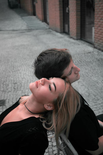 High angle view of couple relaxing on street