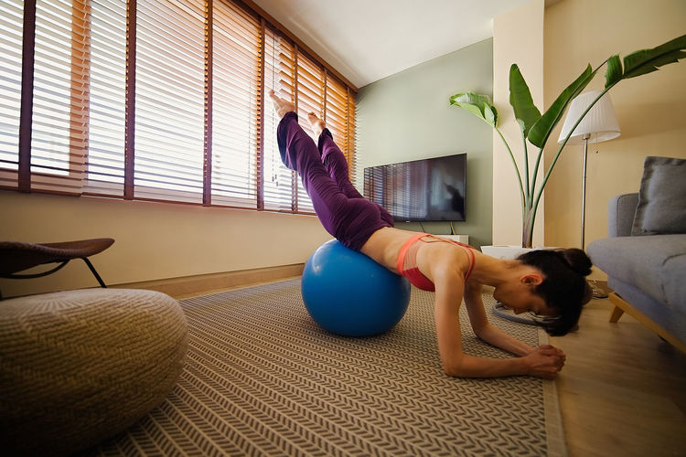 Woman lying down on floor at home