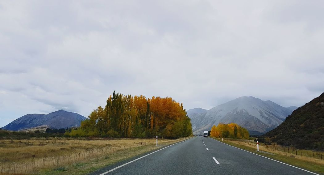 Crossing the Southern Alps in the Southern Autumn Cloud - Sky Mountain Road Landscape The Way Forward Outdoors Tree Scenics Mountain Range Tranquility Nature Road Trip Beauty In Nature Storm Cloud Sky Newzealand NZ