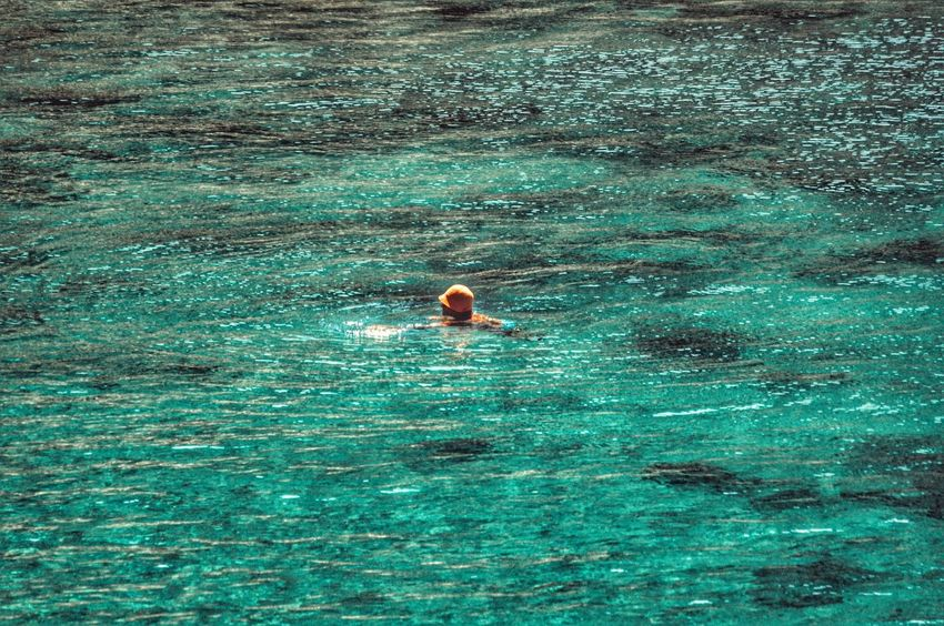 Showcase July Simple Moment Swimming Crystal Clear Waters Turquoise Water Seascape Women Of EyeEm Sunny Day Summertime Simplicity Sun Reflection On Water Summer Views Lifeisbeautiful Enjoying The Moment Malephotographerofthemonth Hat Old Lady Swimming Time From My Point Of View Sea View Simple Photography Zoom In Taking Photos Color Palette - Greek Islands Uniqueness
