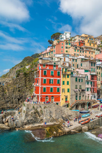 Riomaggiore in Italy Riomaggiore Riomaggiore, Riomaggiore, Italy, Architecture, Sea, Town, Beach, Brick, View, Harbor, Clothes, Sun, Window, Blue, Square, Mediterranean, House, Terrace, Europe, Italian, Colorful, Vacation, Wave, Cloud, Shutters,village, Coast, Wall, Tourism, Beautiful, Holiday, Trave Cinque Terre Water Architecture Building Exterior Sky Built Structure Sea Rock Nature Rock - Object Cloud - Sky Nautical Vessel Day Solid Building Waterfront Rock Formation Land Travel Destinations City No People Outdoors