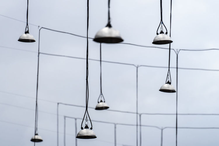 Minimalism Minimalistic Lamps Old Hanging No People Lighting Equipment Choice Opportunity Indoors  Pendant Light Challenge Modern Wall - Building Feature Repetition Focus On Foreground Nature Close-up In A Row Day Bell Order Electric Light White Color Electric Lamp