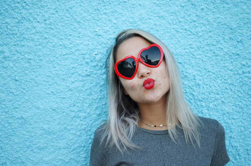 One Person Headshot Glasses Portrait Front View Fashion Sunglasses Hair Hairstyle Long Hair Women Real People Looking At Camera Blue Lifestyles Day Child Leisure Activity Beautiful Woman Teenager Red Heart