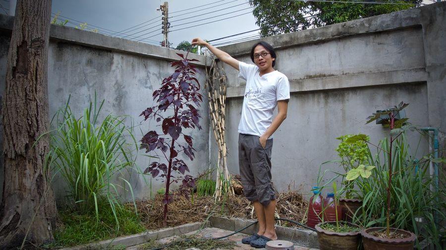 Portrait of mature man standing in yard