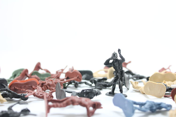 Close-up of plastic toys against white background
