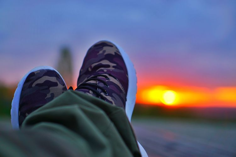 Sunset Love Defocused Background Backgrounds Defocused Backgrounds Background Background Texture Meditation War Shoes Camouflage Camouflage Clothing EyeEmSelect Relax Enjoying Life Happy Awesome Colors Green Red Magenta Low Section Sunset Human Leg Shoe Relaxation Sky Close-up Canvas Shoe Human Foot Footwear Feet
