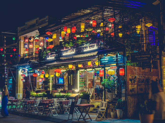 Night Illuminated Business Restaurant Building Exterior Architecture Food And Drink Built Structure City Table Seat Chair Text Cafe No People Multi Colored Store Outdoors Absence Bar Counter Nightlife Store Sign